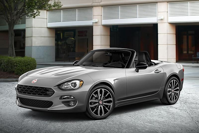 Convertible sales might be down but carmakers continue with droptops shown at New York Auto Show, including Mustang and the Porsche 911 Speedster.