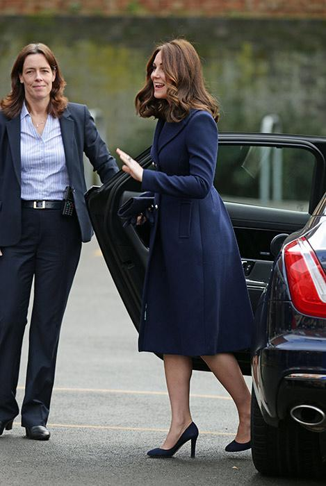 Kate Middleton exiting her limousine in a dark navy blue Hobbs coat