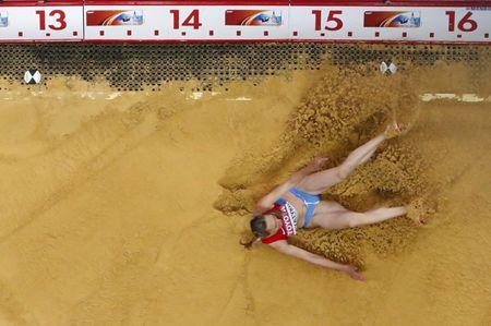 Anna Pyatykh of Russia competes during the women's triple jump final at the IAAF World Athletics Championships at the Luzhniki stadium in Moscow August 15, 2013.           REUTERS/Fabrizio Bensch