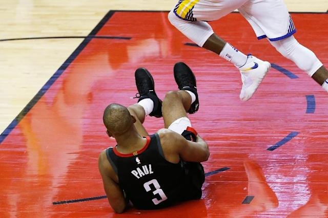 Paul suffered the hamstring injury in the final seconds of Houston's 98-94 home victory in game five Thursday (AFP Photo/Bob Levey)