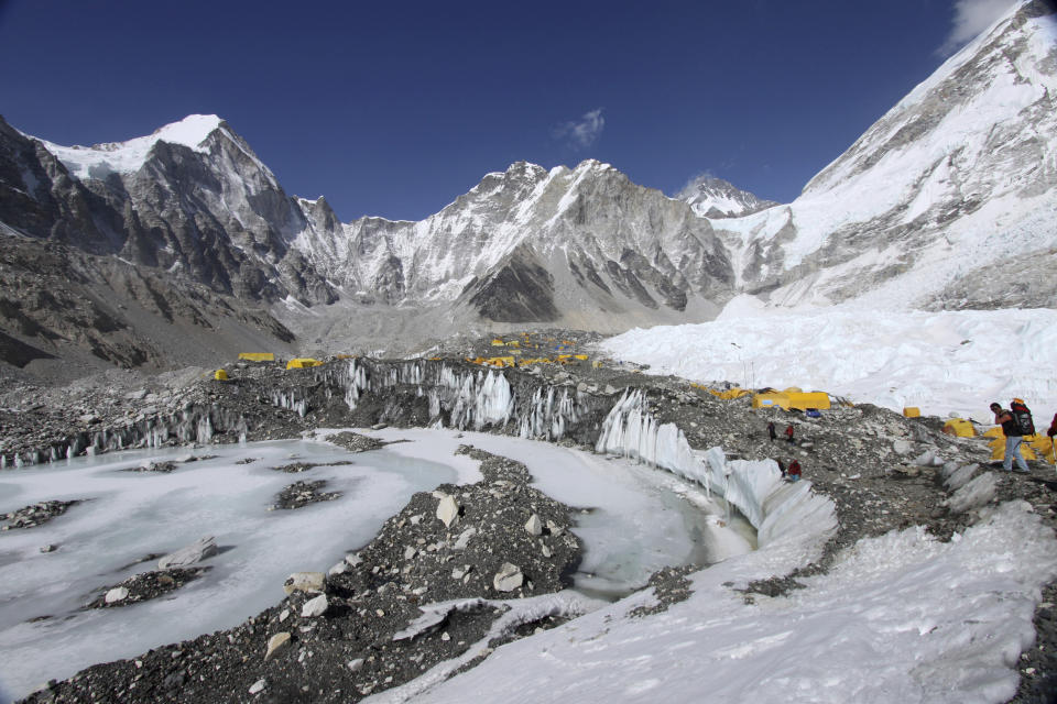FILE - In this April 11, 2015 file photo, tents are seen set up for climbers on the Khumbu Glacier, with Mount Khumbutse, center, and Khumbu Icefall, right, seen in background, at Everest Base Camp in Nepal. The floods that slammed into two hydroelectric plants and damaged villages in northern India were set off by a break on a Himalayan glacier upstream. Glaciers advance and retreat with cycles of snowfall and melting, and can form glacial lakes behind them. This pattern builds up water, as well as a risk the water will break free and flood areas downstream. (AP Photo/Tashi Sherpa, File)