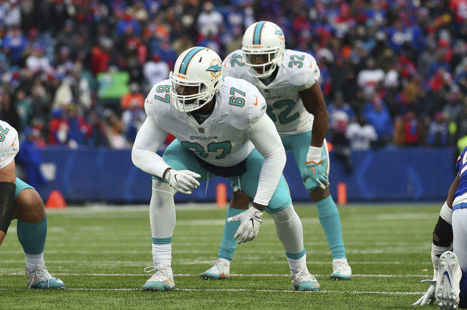 FILE - In this Dec. 17, 2017, file photo, Miami Dolphins offensive tackle Laremy Tunsil (67) lines up against the Buffalo Bills during the second half of an NFL football game in Orchard Park, N.Y. The Houston Texans continued a busy day of trades by addressing a glaring need to upgrade their offensive line by acquiring Tunsil from the Dolphins in a deal which also netted them receiver Kenny Stills, a source familiar with the deal tells The Associated Press. (AP Photo/Rich Barnes, File)