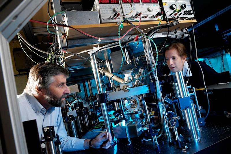 Professor Patrick Gill and Dr Helen Margolis working on one of NPL's trapped ion optical clocks: NPL