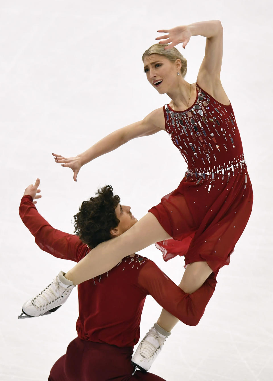 Piper Gilles and Paul Poirier of Canada perform during the Ice Dance-Free Dance at the Figure Skating World Championships in Stockholm, Sweden, Saturday, March 27, 2021. (AP Photo/Martin Meissner)