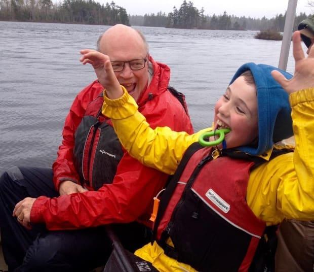 Dr. Robert Strang, Nova Scotia's chief medical officer of health, with his son, now 15. Despite the fact his son has severe physical and intellectual disabilities, Strang says he's confident in the province's age-based approach to determining the order for vaccinating the public.