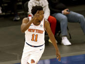 New York Knicks' Frank Ntilikina celebrates his 3-point shot in the second quarter against the Indiana Pacers during an NBA basketball game Saturday, Feb. 27, 2021, in New York. (Elsa/Pool Photo via AP)