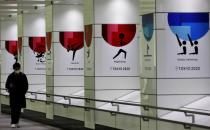 Man walks past posters for 2020 Tokyo Olympic Games, in Tokyo