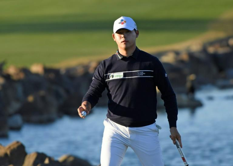 South Korean Kim Si-woo reacts after holing his final putt to win the US PGA Tour American Express event at La Quinta, California