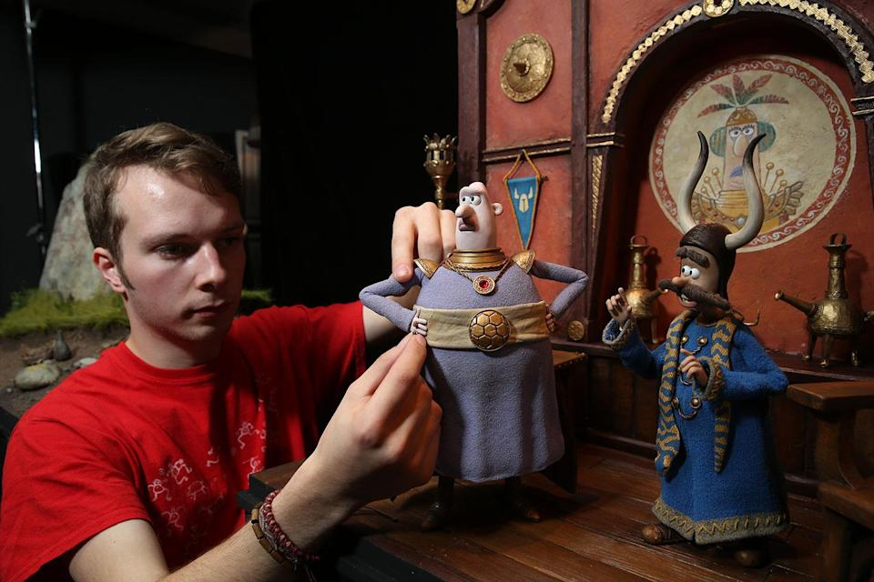 An Aardman animator adjusts a model of Lord Nooth used in the film. (Studiocanal)