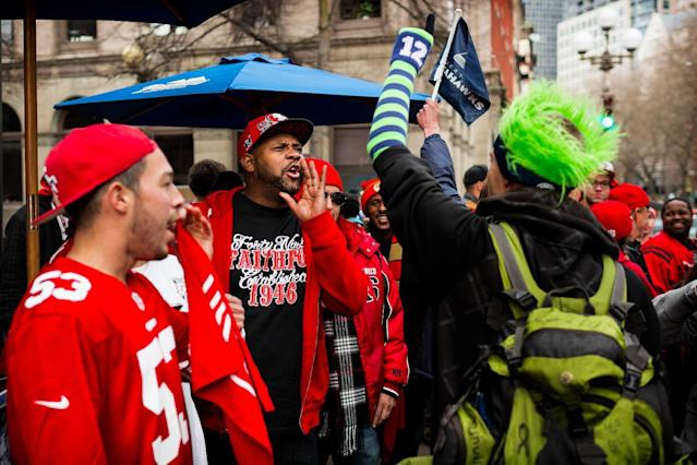 San Francisco 49ers fans playfully heckle a Seattle Seahawks fan during a rally outside of the J and M Cafe a day before the NFC championship face-off between the NFL football teams Saturday, Jan. 18, 2014, in Pioneer Square in Seattle, Wash. Police later showed up on the scene to keep the peace between rival fans. (AP Photo/seattlepi.com, Jordan Stead)