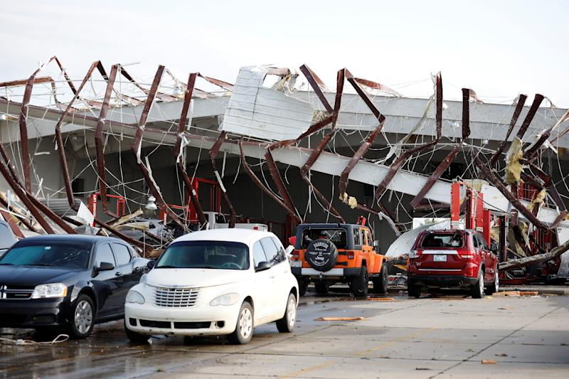 A building at Frontier Car Dealership in El Reno, Okla., collapsed after it was hit by a tornado. (Photo: Alonzo Adams/Reuters)