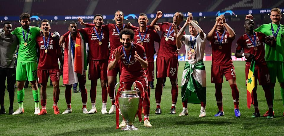 TOPSHOT - Liverpool's Egyptian midfielder Mohamed Salah celebrates with the trophy after winning the UEFA Champions League final football match between Liverpool and Tottenham Hotspur at the Wanda Metropolitano Stadium in Madrid on June 1, 2019. (Photo by JAVIER SORIANO / AFP)        (Photo credit should read JAVIER SORIANO/AFP/Getty Images)