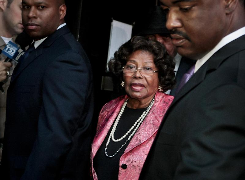 FILE - In this Nov. 7, 2011 file photo, Michael Jackson's mother Katherine Jackson leaves the Criminal Justice Center after it was announced that Dr. Conrad Murray, Michael Jackson's physician when the pop star died in 2009, was found guilty of involuntary manslaughter, in Los Angeles. During the 2013 negligent hiring trial in Los Angeles between Michael Jackson's mother, Katherine Jackson, and concert giant AEG Live, Jackson's mother wants a jury to determine that the promoter of Jackson's planned comeback concerts didn't properly investigate Murray, who a criminal jury convicted of involuntary manslaughter for Jackson's June 2009 death. (AP Photo/Bret Hartman, File)