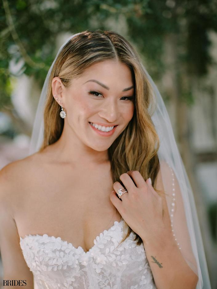 """<p>Ushkowitz <a href=""""https://people.com/tv/glee-star-jenna-ushkowitz-engaged-boyfriend/"""" rel=""""nofollow noopener"""" target=""""_blank"""" data-ylk=""""slk:announced the pair's engagement"""" class=""""link rapid-noclick-resp"""">announced the pair's engagement</a> last August.</p> <p>""""Yes, a million times, yes,"""" the actress <a href=""""https://www.instagram.com/p/CDaBDMCAWe-/"""" rel=""""nofollow noopener"""" target=""""_blank"""" data-ylk=""""slk:captioned"""" class=""""link rapid-noclick-resp"""">captioned </a>a celebratory photo of herself showing off her sparkling engagement ring while standing beside Stanley and their dog, Bear.</p>"""