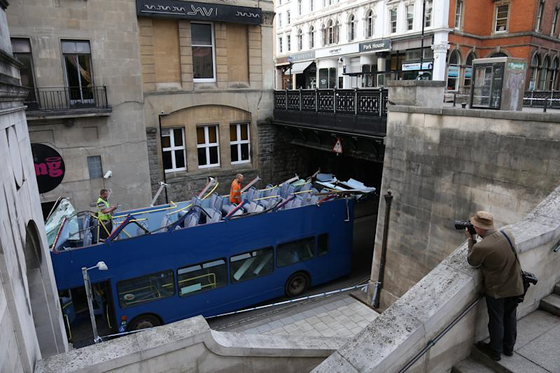 Witnesses said. thebridge 'took. the full impact' of the crash, which also smashed all the bus's windows. (SWNS)