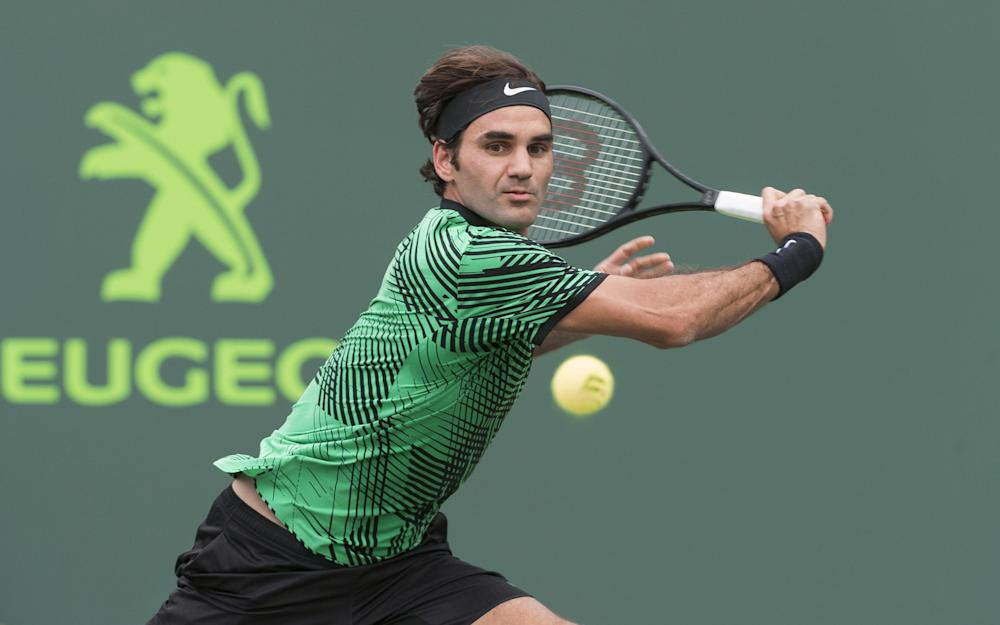 Roger Federer of Switzerland in action on Day 6 at the Miami Open at Crandon Park - Credit: Mike Frey/BPI/REX/Shutterstock