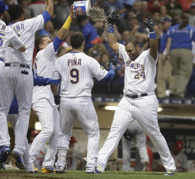 Milwaukee Brewers' Jesus Aguilar celebrates his walk off home run during the ninth inning of a baseball game against the St. Louis Cardinals Friday, June 22, 2018, in Milwaukee. The Brewers won 2-1. (AP Photo/Morry Gash)