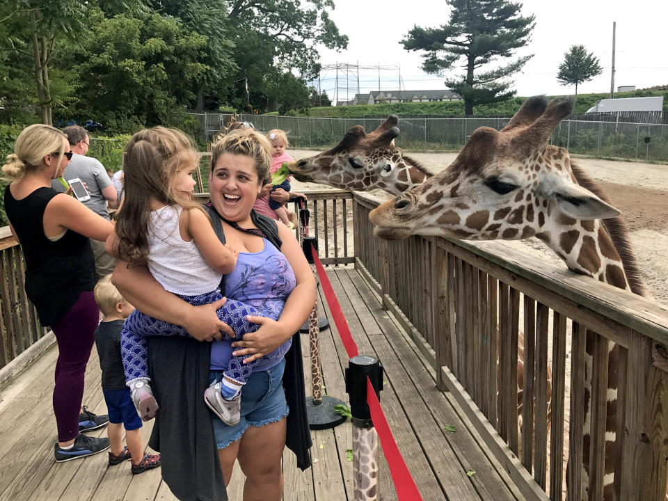 Morgan said she never truly realised how 'unhealthy' she had become until seeing an 'unflattering' photograph of herself and her daughter while at the zoo in September 2017. Photo: Caters News