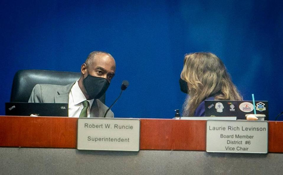 Broward Schools Superintendent Robert W. Runcie, left, talks to Broward School Board Vice Chair Laurie Rich Levinson before the start of the School Board meeting. The board convened a special meeting Thursday, April 29, 2021, so it can authorize the chair and the lawyers to begin a termination agreement with Runcie, who offered to resign on Tuesday following his April 15 indictment on a perjury charge related to a statewide grand jury investigation.