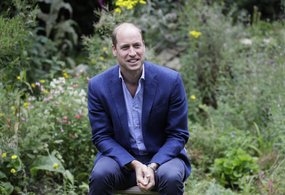 Britain's Prince William, Duke of Cambridge socially distances as he speaks with service users during a visit to the Garden House of the Light Project in Peterborough, on July 16, 2020, which offers information, advice and support to the rough sleepers in Peterborough. (Photo by Kirsty Wigglesworth / POOL / AFP) (Photo by KIRSTY WIGGLESWORTH/POOL/AFP via Getty Images)