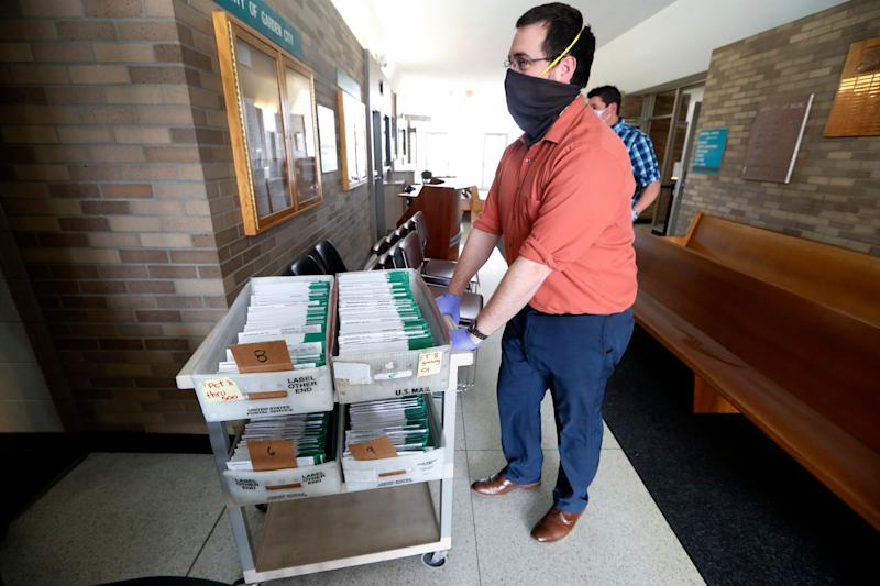 Michigan voters won't have to worry about their mailed absentee ballots (pictured above) being returned late after a judge extended the ballot receipt deadline by 14 days. (AP Photo/Paul Sancya) (Photo: ASSOCIATED PRESS)