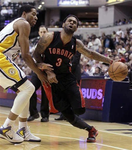 Toronto Raptors forward Gary Forbes, right, reacts as he's fouled by Indiana Pacers forward Danny Granger in the first half of an NBA basketball game in Indianapolis, Monday, April 9, 2012. (AP Photo/Michael Conroy)