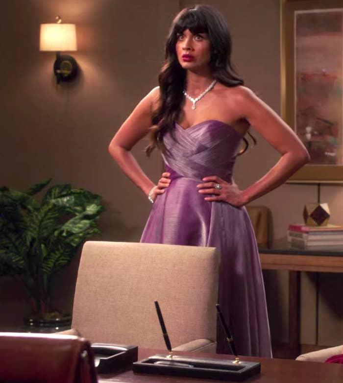 Tahani wearing a strapless gown