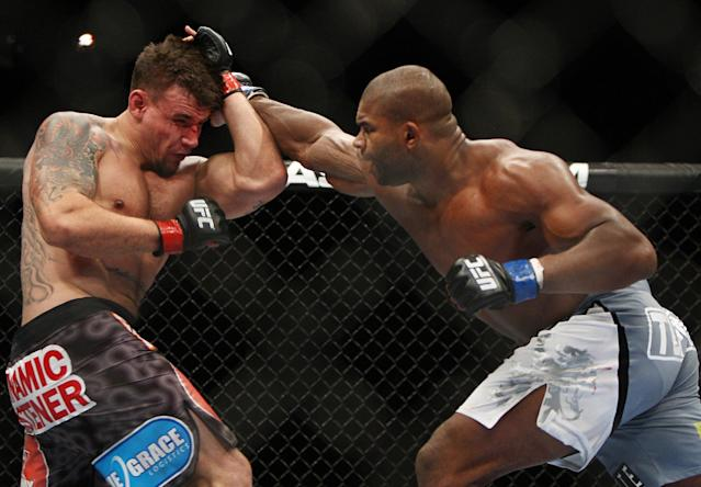 Frank Mir, left, and Alistair Overeem, of the Netherlands, fight during the second round of a UFC 169 heavyweight mixed martial arts bout in Newark, N.J., Saturday, Feb. 1, 2014. Overeem won by unanimous decision. (AP Photo/Tim Larsen)