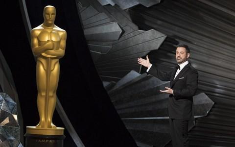"The Academy Awards attracted its smallest American television audience ever on Sunday, according to Nielsen data reported by Walt Disney Co's ABC network, tracking a similar slide for other recent award shows and sports events. Live TV broadcasts remain relatively attractive for advertisers because watchers cannot skip commercials, with prices for Oscars ad spots climbing despite 2017 viewership, which was the smallest in nine years. The nearly four-hour live show averaged 26.5 million total viewers, according to Nielsen data in an ABC statement, down from 32.9 million in 2017 and below the 32 million in 2008, now the second-least watched year. The figures do not include digital and mobile viewing. The 90th Oscars, still expected to be 2018's most-watched nonsporting US television event, honoured romantic fantasy The Shape of Water as best picture. Jimmy Kimmel hosted the ceremony Credit: Disney ABC ceremony The event built on the socially conscious tone of its past few years with themes of female empowerment and activism, but lacked any shocking moments like 2017's best picture mix-up. Late night talk show host Jimmy Kimmel, host for the past two years, skewered industry-roiling sexual misconduct allegations and reports of gender-based pay disparities, while best actress winner Frances McDormand called for ""inclusion riders"" to boost Hollywood diversity. Oscars 2018 