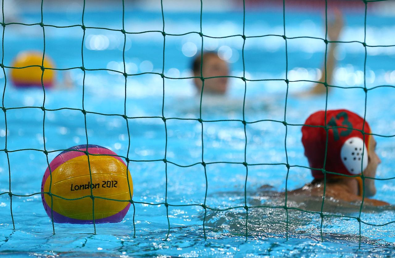 LONDON, ENGLAND - JULY 22:  A Water Polo ball sits in net as The Australian Water Polo team trains at the Water Pool Venue in the Olympic Park on July 22, 2012 in London, England.  (Photo by Al Bello/Getty Images)