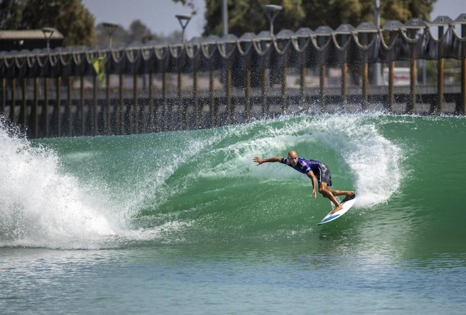 Surf Ranch innovator and 11-time world champion surfer Kelly Slater, of Florida, does a slashing turn off a wave.