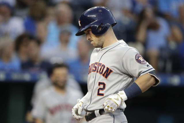 Houston Astros' Alex Bregman runs home to score after hitting a solo home run during the fourth inning of a baseball game against the Kansas City Royals on Saturday, Sept. 14, 2019, in Kansas City, Mo. (AP Photo/Charlie Riedel)