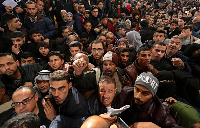 <p>Palestinians in Gaza wait for travel permits to cross into Egypt through the Rafah border crossing after it was opened by Egyptian authorities for humanitarian cases, Feb. 8, 2018. (Photo: APAImages/REX/Shutterstock) </p>