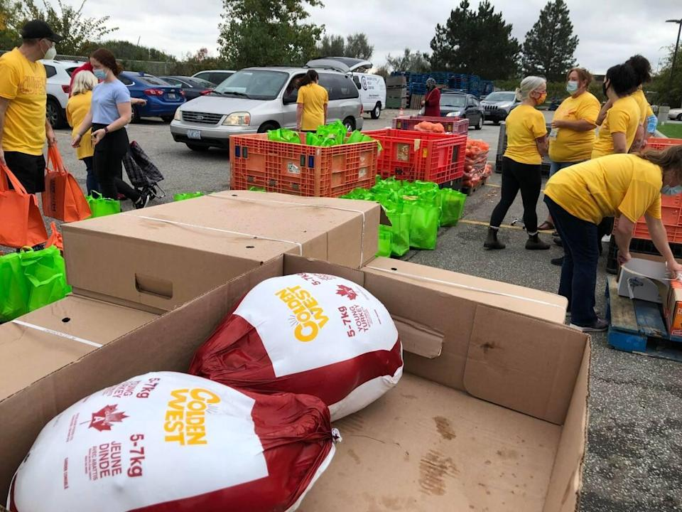 Turkeys, chickens and all the fixings were distributed on Friday, Oct. 8, at the UHC—Hub of Opportunities. (Darrin Di Carlo/CBC - image credit)