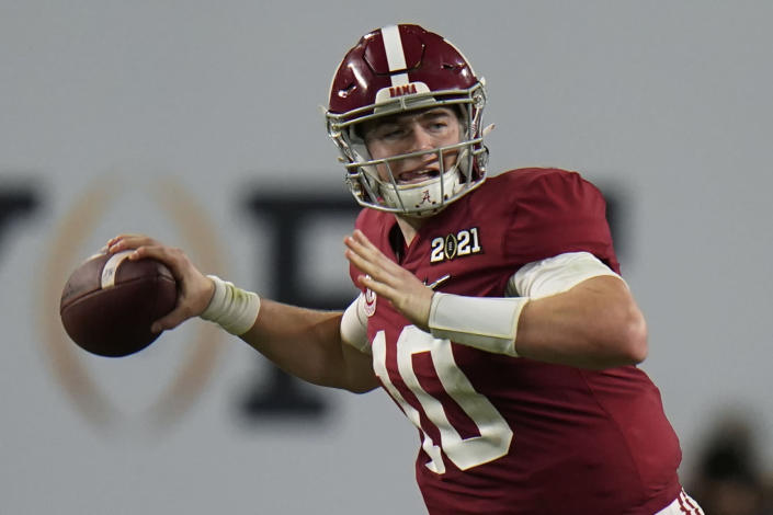 FILE - Alabama quarterback Mac Jones passes against Ohio State during the second half of an NCAA College Football Playoff national championship game in New Orleans, in this Monday, Jan. 11, 2021, file photo. Jones is a likely first round pick in the NFL Draft, April 29-May 1, 2021, in Cleveland.(AP Photo/Chris O'Meara, File)