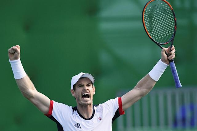 Andy Murray became the first male player to win two Olympic singles titles when he beat Juan Martin del Potro in a four hour slugfest in the 2016 Games in Rio (AFP Photo/Martin BERNETTI)