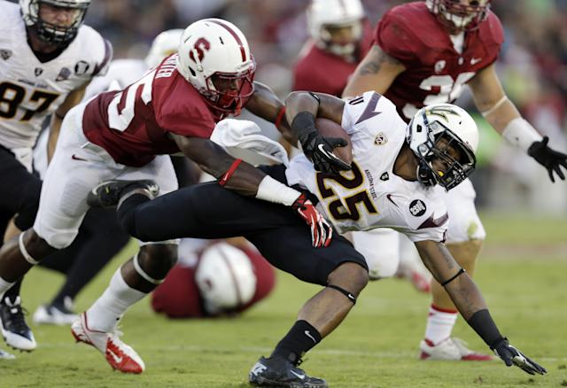 Arizona State's Deantre Lewis, right, is brought down by Stanford cornerback Alex Carter during the second half of an NCAA college football game Saturday, Sept. 21, 2013, in Stanford, Calif. Stanford won 42-28. (AP Photo/Marcio Jose Sanchez)
