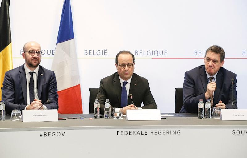 Belgium's Prime Minister Charles Michel, France's President Francois Hollande (C) and Interior Minister Jan Jambon (R) give a joint press conference on March 18, 2016 in Brussels
