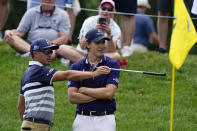 Rickie Fowler, left, talks with Carlos Ortiz, of Mexico, on the 10th green during the third round of the Memorial golf tournament, Saturday, June 5, 2021, in Dublin, Ohio. (AP Photo/Darron Cummings)