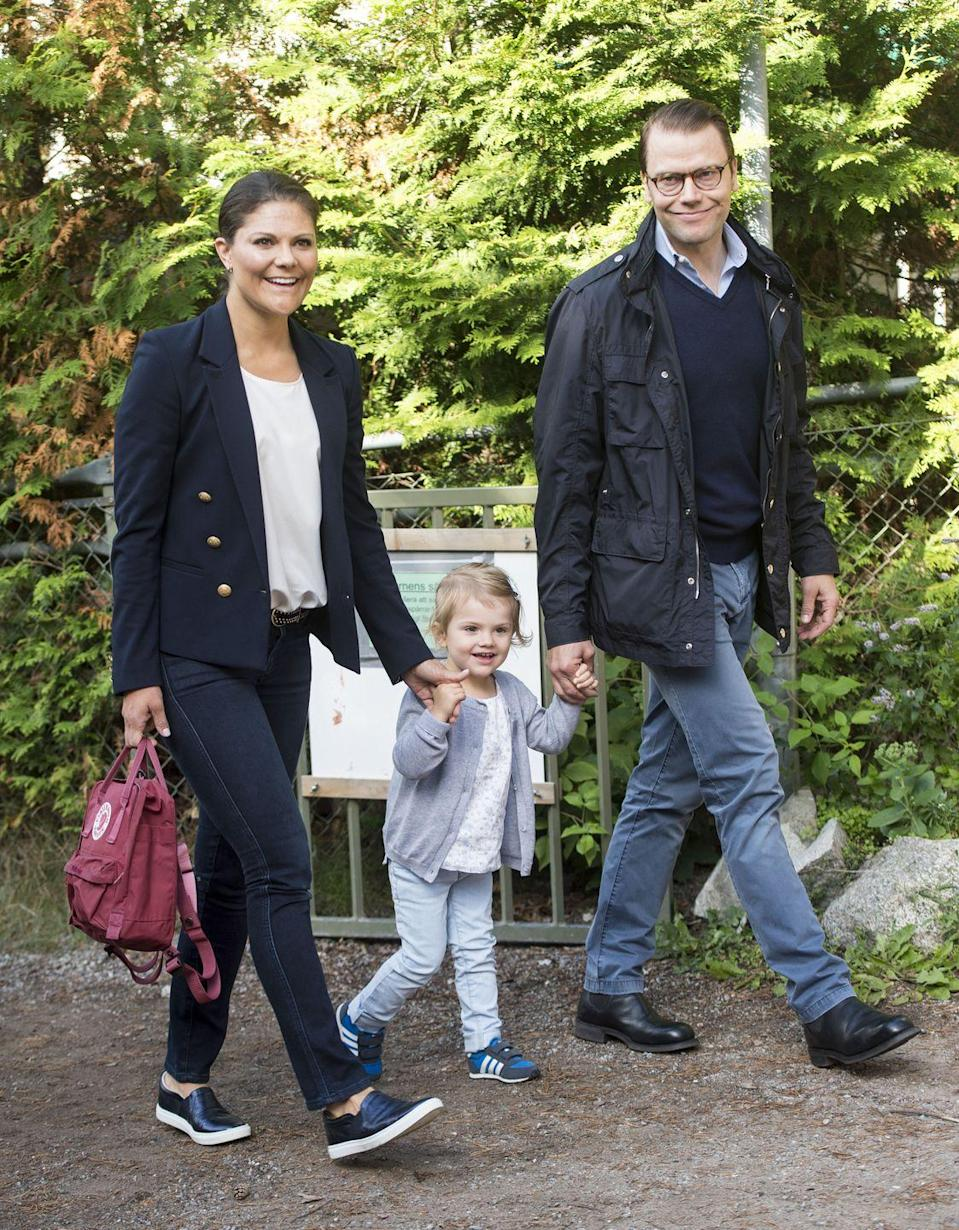 "<p>Princess Victoria of Sweden and Prince Daniel, Duke of Vastergotland, walk an exuberant <a href=""https://www.townandcountrymag.com/society/tradition/a14470390/swedish-royal-family-holiday-card/"" rel=""nofollow noopener"" target=""_blank"" data-ylk=""slk:Princess Estelle"" class=""link rapid-noclick-resp"">Princess Estelle</a> to her first day at pre-school in Stockholm, Sweden.</p>"