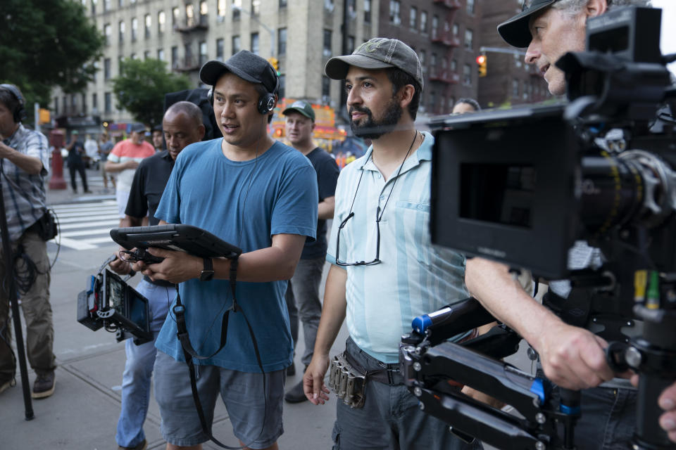 """This image released by Warner Bros. Pictures shows director John Chu, left, and Lin-Manuel Miranda on the set of """"In the Heights."""" (Macall Polay/Warner Bros. via AP)"""