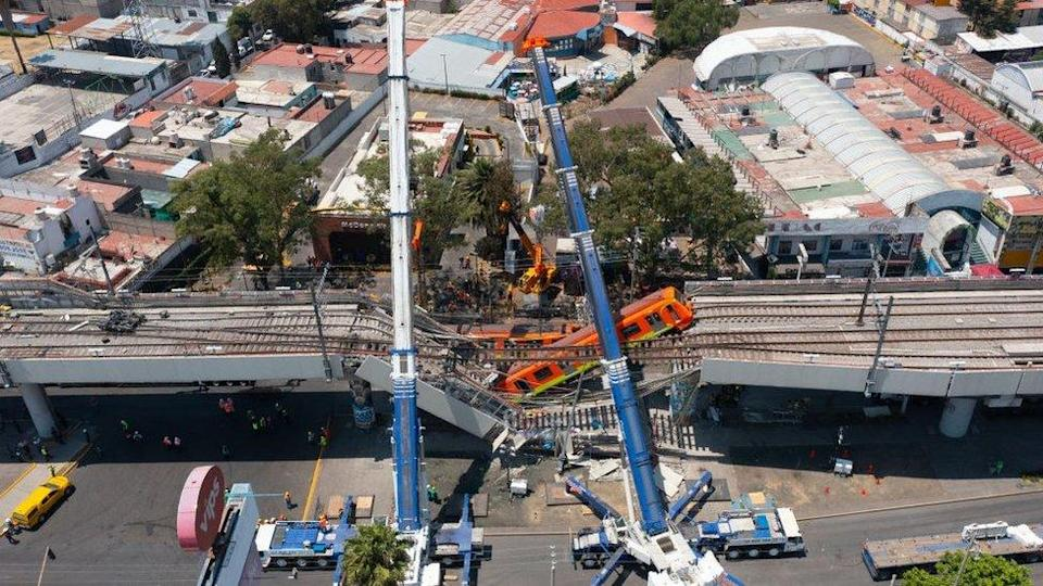 Aerial view of the works to remove the damaged train after a train overpass collapsed last night killing 23 people on May 04, 2021 in Mexico City, Mexico