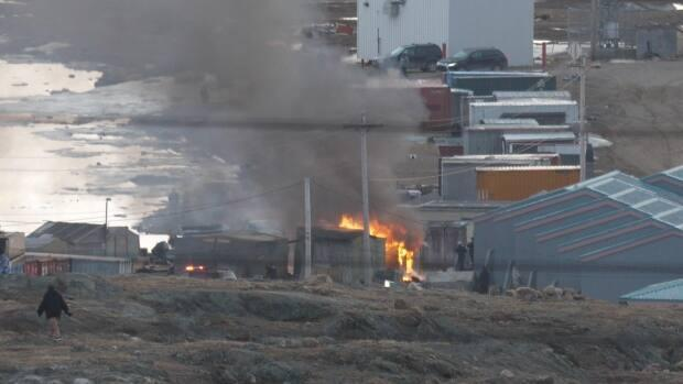 A view of the fire behind the Iqaluit Northmart Thursday night. Two shacks were destroyed in the fire, and two more were damaged.   (David Gunn/CBC - image credit)