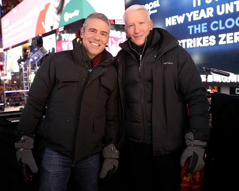 Andy Cohen (left) and Anderson Cooper (right) pose in the New York City streets