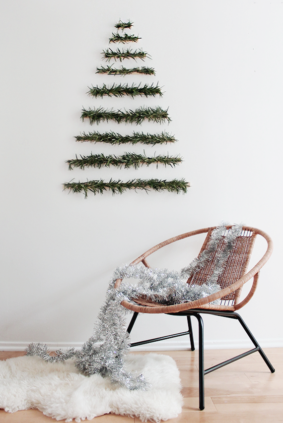 "<p>If it just isn't Christmas without fresh greenery for you, try this DIY. Just glue greenery to wooden dowels, then stack on your wall in the shape of a tree.</p><p>Get the tutorial at <a href=""http://almostmakesperfect.com/2014/12/03/diy-makeshift-xmas-tree-wall-hanging/"" rel=""nofollow noopener"" target=""_blank"" data-ylk=""slk:Almost Makes Perfect"" class=""link rapid-noclick-resp"">Almost Makes Perfect</a>.</p>"