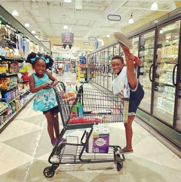 PHOTO: Maximus Turner, 8, and Liliana, 6, pose while shopping at a grocery store. Maximus Turner choreographed an at-home ballet recital for himself and his sister during the coronavirus pandemic. (Michelle Turner)