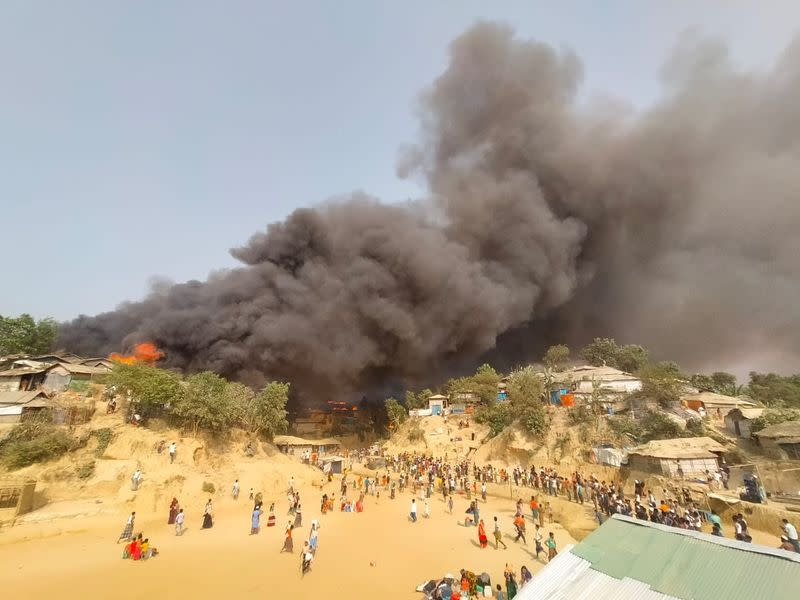 A fire is seen at a Balukhali refugee camp in Cox's Bazar