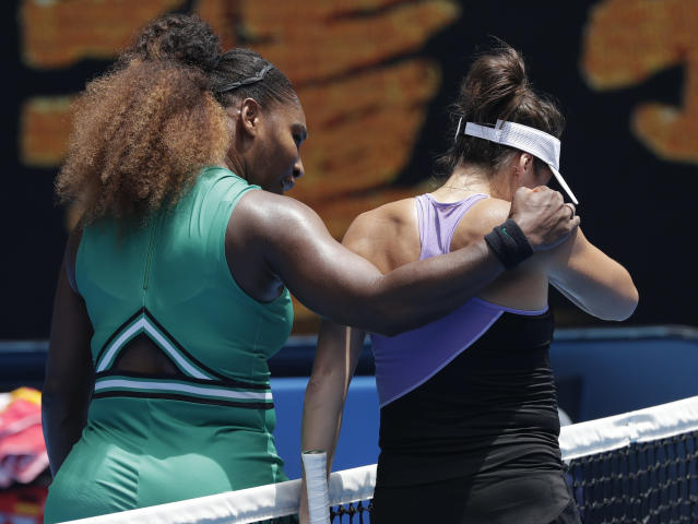 United States' Serena Williams, left, embraces Germany's Tatjana Maria at the net following their first round match at the Australian Open tennis championships in Melbourne, Australia, Tuesday, Jan. 15, 2019. (AP Photo/Kin Cheung)
