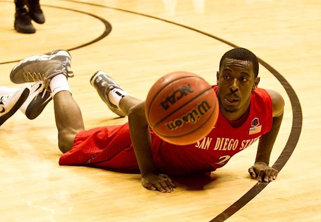 San Diego State guard Xavier Thames (2) dives after the ball Tuesday, Feb. 11, 2014, against the University of Wyoming at the Arena-Auditorium in Laramie, Wyo. (AP Photo/Jeremy Martin)