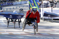Daniel Romanchuk, of Mount Airy, Md., crosses the finish line to win the pro wheelchair men's division of the New York City Marathon, in New York's Central Park, Sunday, Nov. 3, 2019. (AP Photo/Richard Drew)